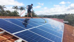 Technician cleaning solar panels